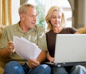 Couple at Home Sorting Finances